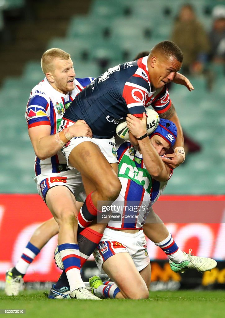 Kane Evans of the Roosters is tackled during the round 20 NRL match between the Sydney Roosters and the Newcastle Knights at Allianz Stadium on July 21, 2017 in Sydney, Australia.