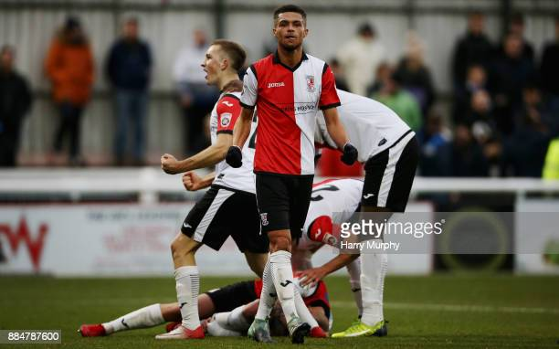 Kane Ferdinand of Woking celebrates his teams first goal scored by Joe Ward during the Emirates FA Cup Second Round match between Woking and...