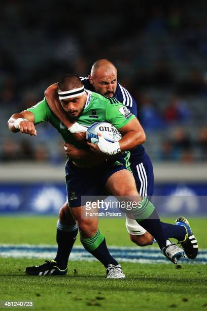 Kane Hames of the Highlanders makes a break during the round seven Super Rugby match between the Blues and the Highlanders at Eden Park on March 29...