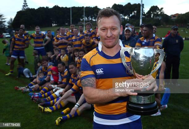 Kane Hancy of Patamahoe celebrates with the McNamara Cup after defeating Karaka during the Counties Club Rugby Final between Patumahoe and Karaka at...