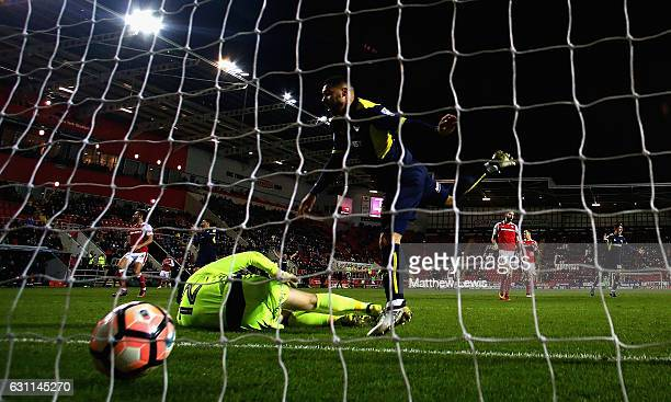 Kane Hemmings of Oxford United beats Lewis Price of Rotherham United to score his teams third goal during The Emirates FA Cup Third Round match...