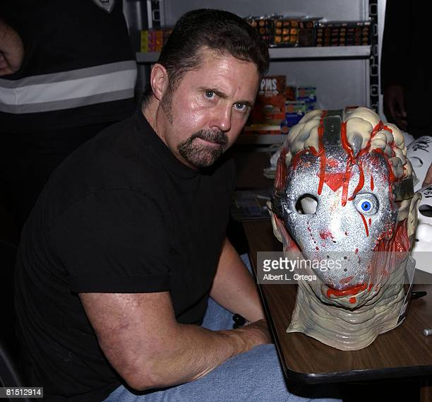 Kane Hodder poses with his movie likeness