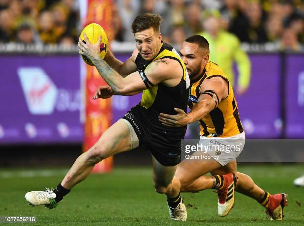 Kane Lambert of the Tigers is tackled by Jarman Impey of the Hawks during the AFL First Qualifying Final match between the Richmond Tigers and the...
