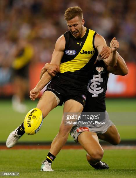 Kane Lambert of the Tigers is tackled during the 2018 AFL round 01 match between the Richmond Tigers and the Carlton Blues at the Melbourne Cricket...