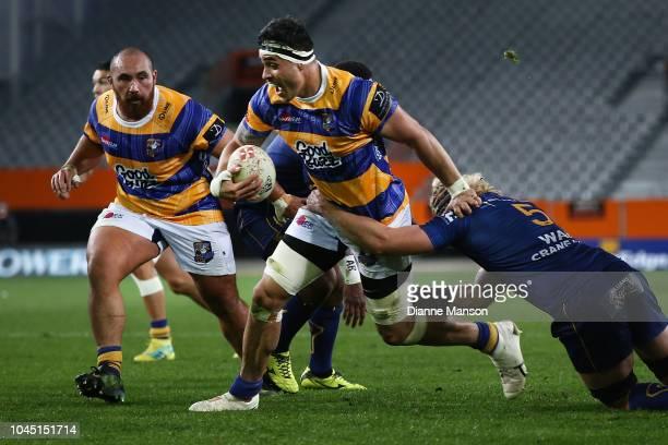 Kane Le'Aupepe of Bay of Plenty is tackled by Josh Dickson of Otago during the round eight Mitre 10 Cup match between Otago and Bay of Plenty at...