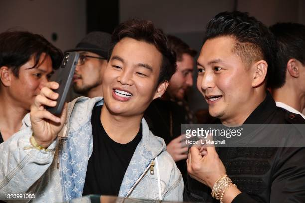 Kane Lim and Kyle Chan pose with a diamond ring at Kyle Chan's Retail Store Opening at Kyle Chan Design on June 16, 2021 in Los Angeles, California.