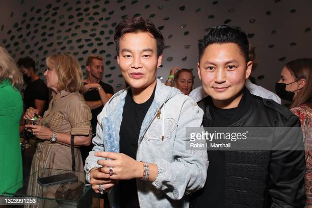 Kane Lim poses with Jeweler Kyle Chan wearing custom made diamond ring at Kyle Chan's Retail Store Opening at Kyle Chan Design on June 16, 2021 in...