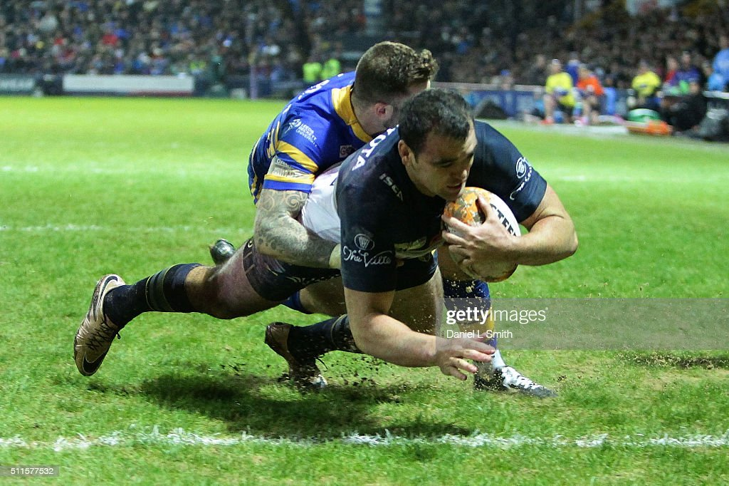Kane Linnett of North Queensland Cowboys crosses over to score his team a try during the World Club Series match between Leeds Rhinos and North Queensland Cowboys, at Headingley Carnegie Stadium, on February 21, 2016 in Leeds, England.