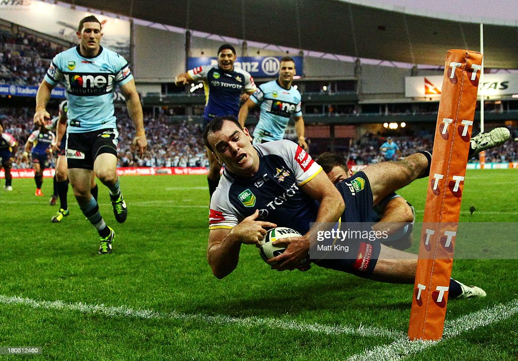 Kane Linnett of the Cowboys is ruled to be in touch as he puts the ball down in the corner which would have been the match winnig try during the NRL Elimination Final match between the Cronulla Sharks and the North Queensland Cowboys at Allianz Stadium on September 14, 2013 in Sydney, Australia.