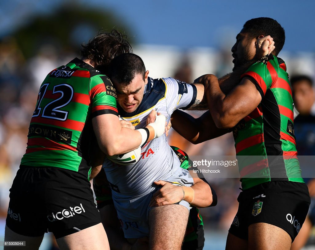 Kane Linnett of the Cowboys is tackled by Angus Crichton and Robert Jennings of the Rabbitohs during the round 19 NRL match between the South Sydney Rabbitohs and the North Queensland Cowboys at Barlow Park on July 16, 2017 in Cairns, Australia.
