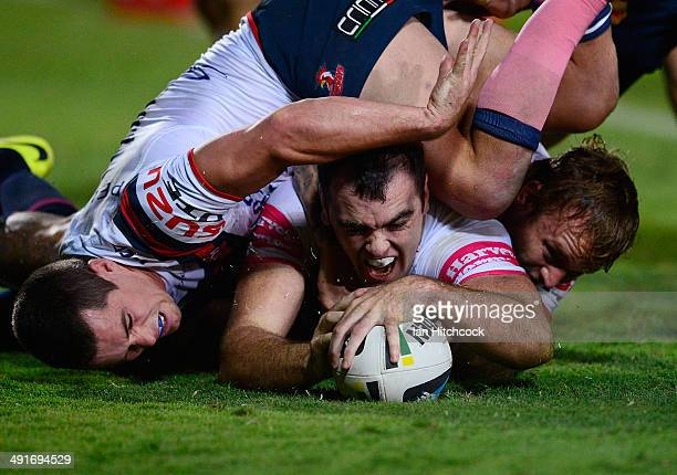 Kane Linnett of the Cowboys scores a try during the round 10 NRL match between the North Queensland Cowboys and the Sydney Roosters at 1300SMILES...