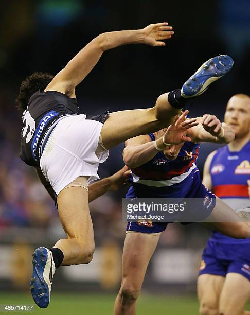 Kane Lucas of the Blues and Adam Cooney of the Bulldogs contest for the ball during the round five AFL match between the Western Bulldogs and the...