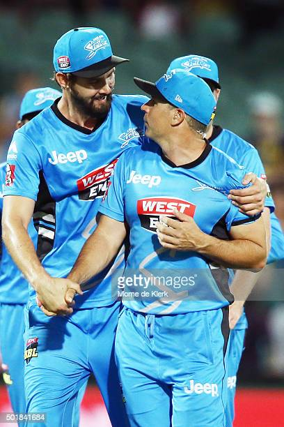 Kane Richardson and Brad Hodge of the Adelaide Strikers celebrates after the Big Bash League match between the Adelaide Strikers and the Melbourne...
