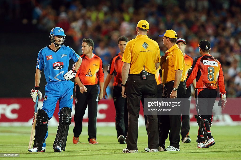 Kane Richardson of Adelaide waits for a review by the umpires before being given out during the Big Bash League match between the Adelaide Strikers and the Perth Scorchers at Adelaide Oval on January 10, 2013 in Adelaide, Australia.