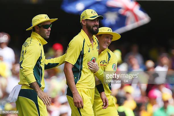 Kane Richardson of Australia celebrates with team mates after a throw that dismissed Virat Kohli of India with a run out during game two of the...