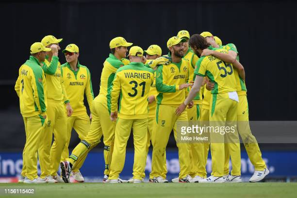 Kane Richardson of Australia celebrates with team mates after dismissing Dimuth Karunaratne of Sri Lanka during the Group Stage match of the ICC...