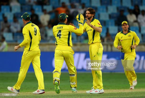 Kane Richardson of Australia celebrates with team-mates after dismissing Haris Sohail of Pakistan during the 5th One Day International match between...