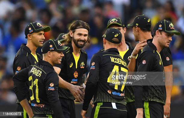Kane Richardson of Australia is congratulated by team mates after taking the wicket of Kusal Mendis of Sri Lanka during game three of the Men's...