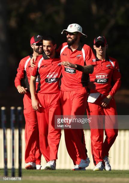 Kane Richardson of South Australia celebrates with team mates after running out Jordan Silk of Tasmania during the JLT One Day Cup match between...