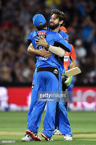 Kane Richardson of the Adelaide Strikers celebrates with Travis Head of the Adelaide Strikers after bowling out Brad Hogg of the Scorchers during the...