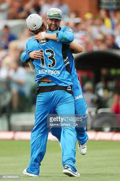 Kane Richardson of the Adelaide Strikers congratulates teammate Alex Ross after he took a catch to dismiss Michael Lumb of the Sydney Sixers during...