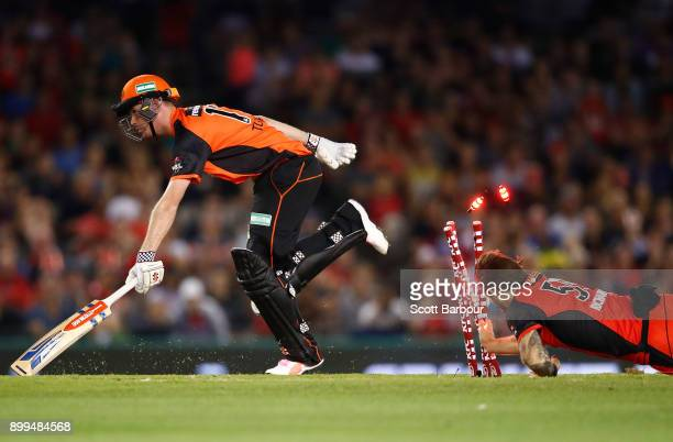 Kane Richardson of the Renegades attempts to run out Andrew Tye of the Scorchers during the Big Bash League match between the Melbourne Renegades and...