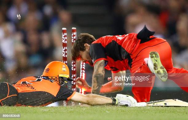 Kane Richardson of the Renegades runs out Jhye Richardson of the Scorchers during the Big Bash League match between the Melbourne Renegades and the...