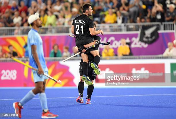 Kane Russell of New Zealand celebrates victory with team mates after winning the semi final match between New Zealand and India during Hockey on day...
