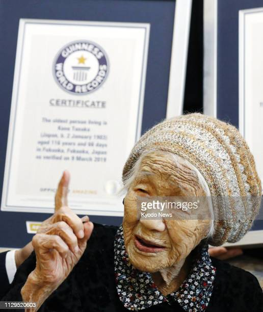 Kane Tanaka receives a certificate in Fukuoka southwestern Japan on March 9 from Guinness World Records recognizing her as the world's oldest living...