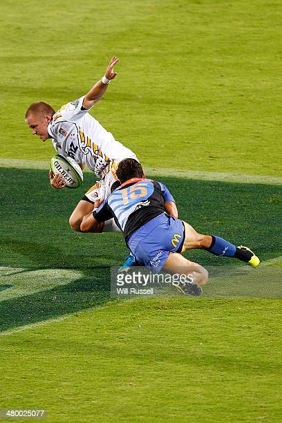 Kane Thompson of the Chiefs is tackled by Jayden Hayward of the Force during the round six Super Rugby match between the Force and the Chiefs at nib...