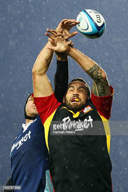 Kane Thompson of the Chiefs wins lineout ball against Ali Williams of the Blues during the round two Super Rugby match between the Chiefs and the...