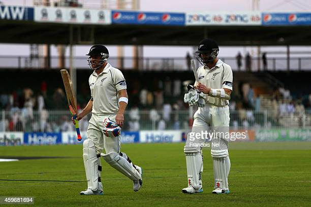 Kane Williamson and Brendon McCullum leave the field at the end of play during day two of the third test between Pakistan and New Zealand at Sharjah...