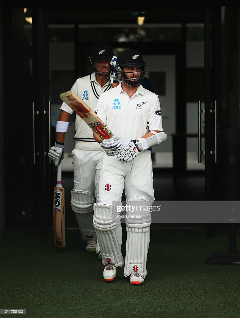 Kane Williamson and Corey Anderson of New Zealand walk out to bat during day four of the Test match between New Zealand and Australia at Hagley Oval on February 23, 2016 in Christchurch, New Zealand.