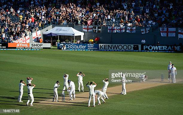 Kane Williamson and his New Zealand fielders react after bowling to Monty Panesar of England during day five of the Third Test match between New...