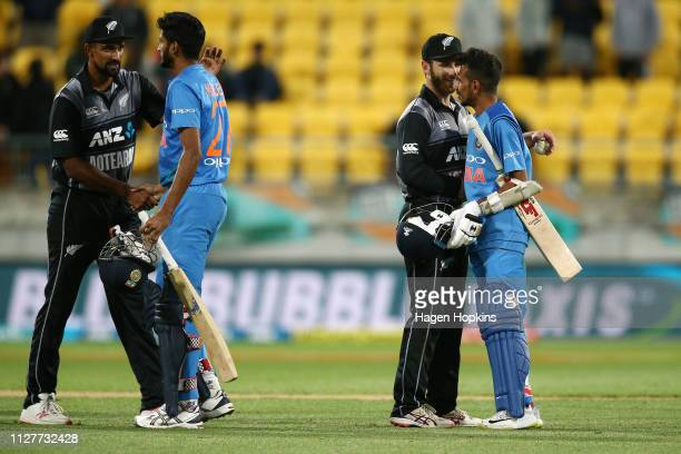 Kane Williamson and Ish Sodhi of New Zealand shake hands with Khaleel Ahmed and Yuzvendra Chahal of India during game one of the International T20...