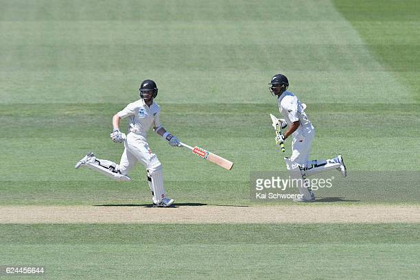 Kane Williamson and Jeet Raval of New Zealand make a run during day four of the First Test between New Zealand and Pakistan at Hagley Oval on...