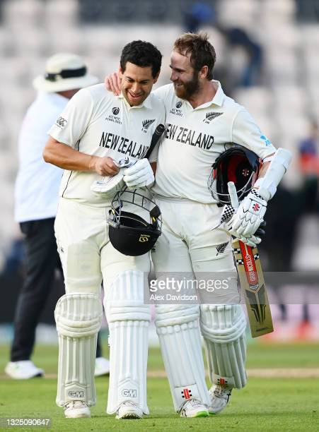 Kane Williamson and Ross Taylor of New Zealand celebrate victory as they walk off on the Reserve Day of the ICC World Test Championship Final between...