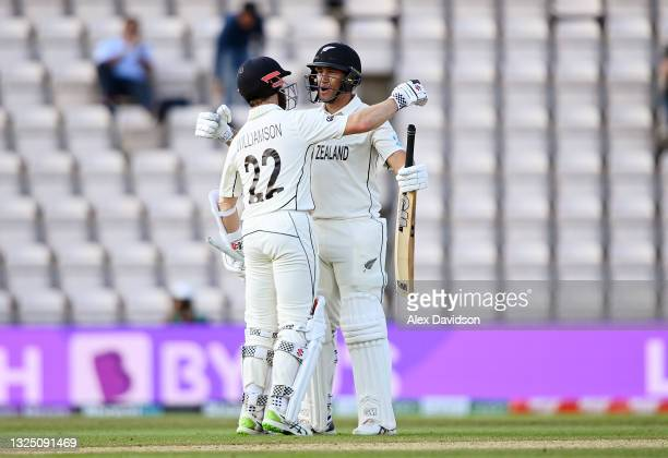 Kane Williamson and Ross Taylor of New Zealand celebrate victory after the Reserve Day of the ICC World Test Championship Final between India and New...