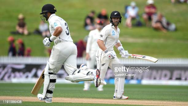 Kane Williamson and Ross Taylor of New Zealand score runs during day 5 of the second Test match between New Zealand and England at Seddon Park on...