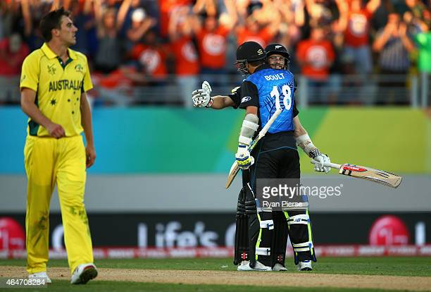 Kane Williamson and Trent Boult of New Zealand celebrate after hitting the winning runs during the 2015 ICC Cricket World Cup match between Australia...