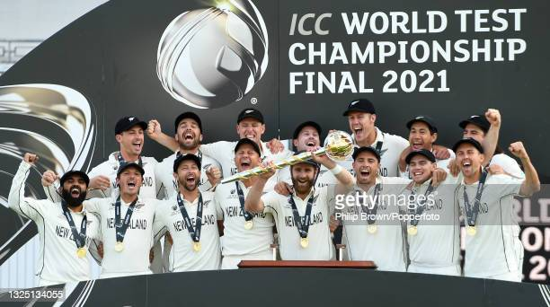 Kane Williamson, captain of of New Zealand holds the Test mace with team mates after the ICC World Test Championship Final against India at The...