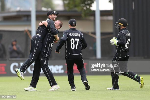 Kane Williamson Colin Munro Lockie Ferguson and Tom Latham of New Zealand celebrate the dismissal of Hassan Ali of Pakistan during the third game of...