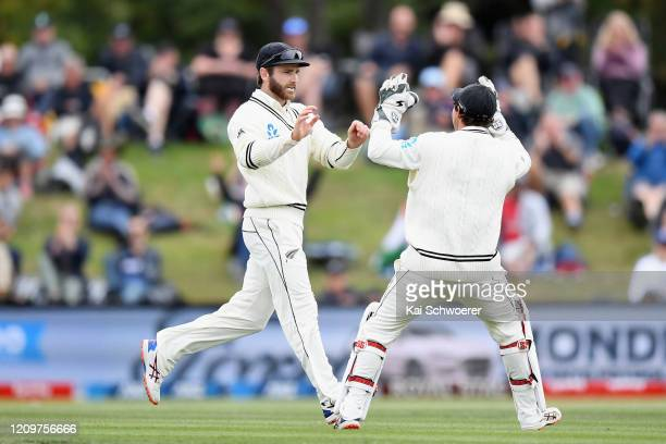 Kane Williamson of New Zealand and BJ Watling of New Zealand celebrate the dismissal of Jasprit Bumrah of India during day three of the Second Test...