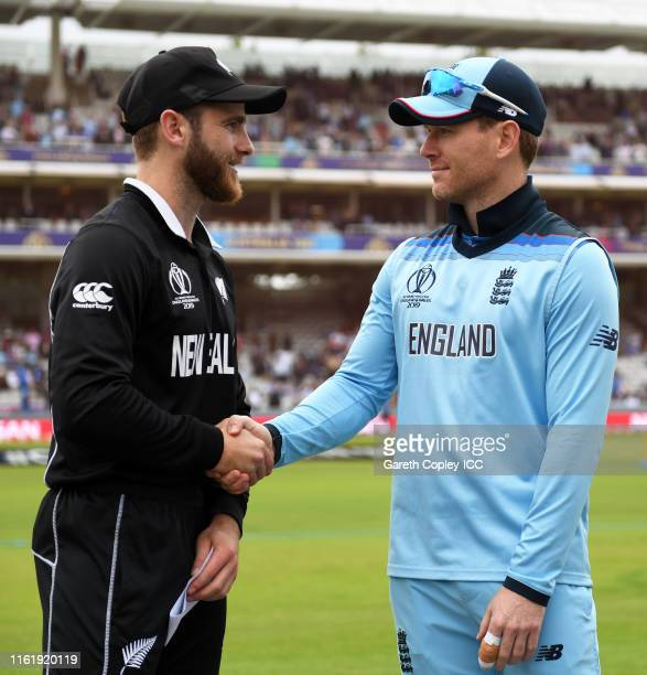 Kane Williamson of New Zealand and Eoin Morgan of England shake hands during the Final of the ICC Cricket World Cup 2019 between New Zealand and...