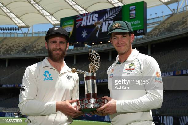 Kane Williamson of New Zealand and Tim Paine of Australia pose with the TransTasman trophy during a media opportunity ahead of the First Test in the...