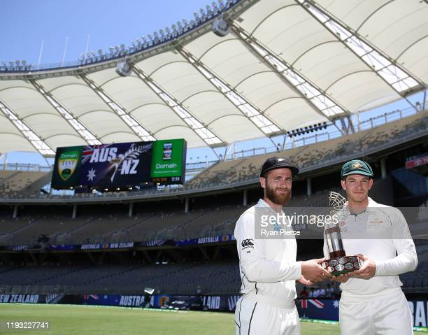 Kane Williamson of New Zealand and Tim Paine of Australia pose with the Trans Tasman Trophy during a media opportunity ahead of the First Test in the...