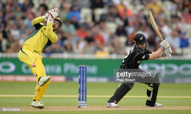 Kane Williamson of New Zealand bats as Matthew Wade of Australia reacts during the ICC Champions Trophy match between Australia and New Zealand at...