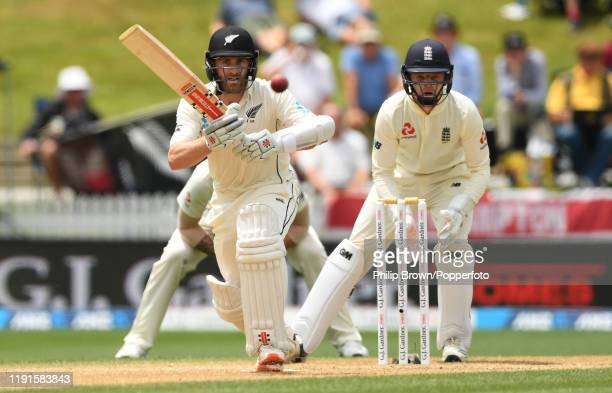 Kane Williamson of New Zealand bats watched by Ollie Pope of England during day 5 of the second Test match between New Zealand and England at Seddon...