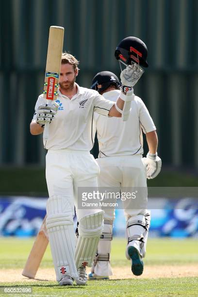 Kane Williamson of New Zealand celebrates his century during day three of the First Test match between New Zealand and South Africa at University...