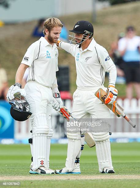 Kane Williamson of New Zealand celebrates his century with teammate BJ Watling during day four of the Second Test match between New Zealand and Sri...
